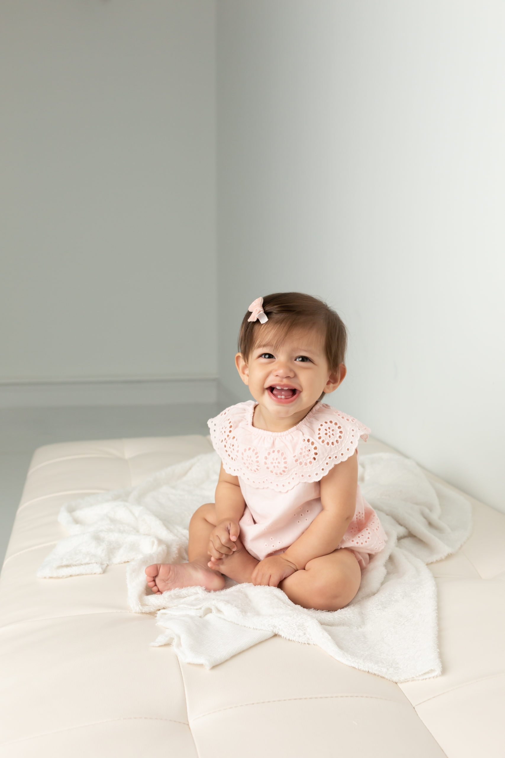 9 month old girl smiling