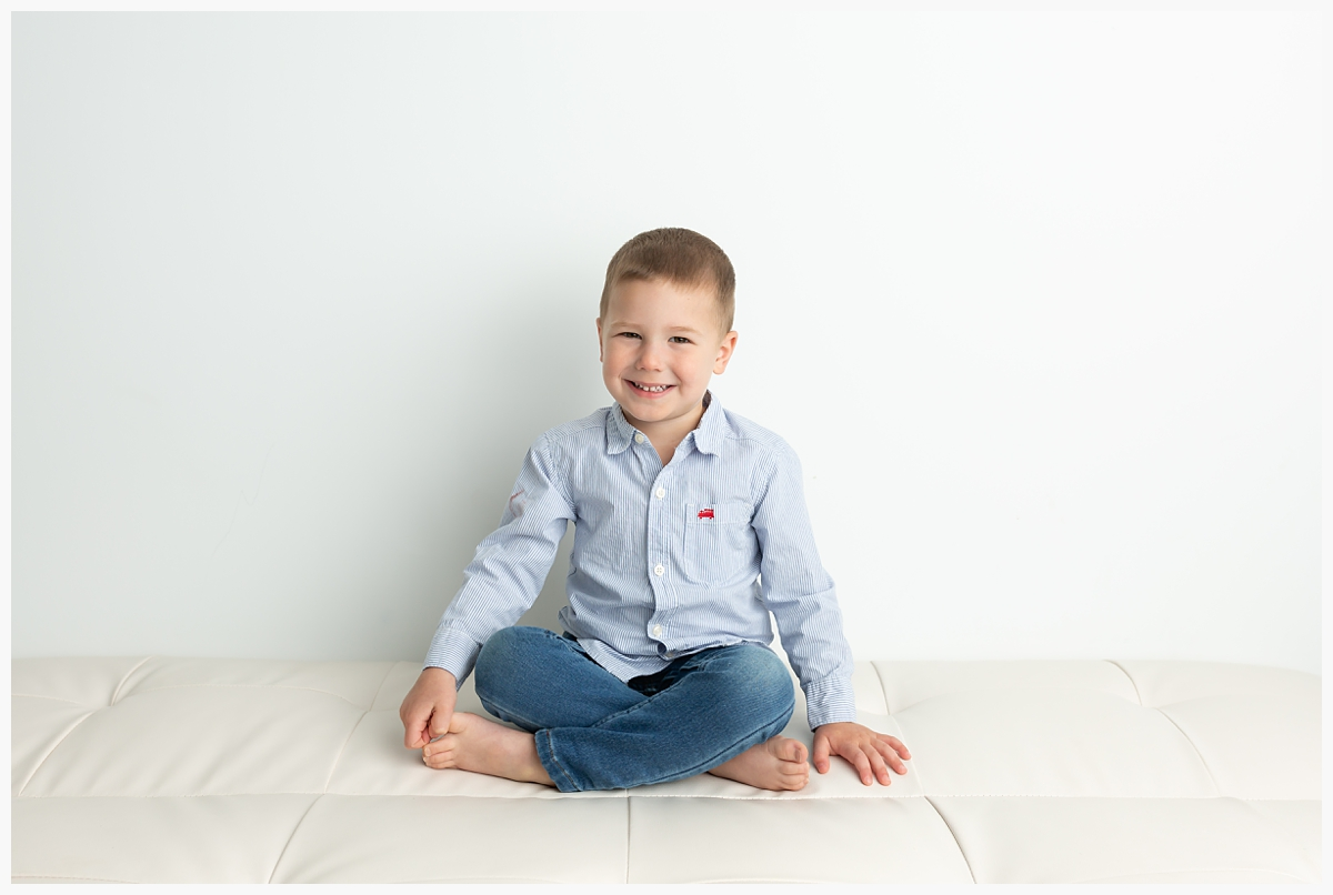 toddler boy on neutral couch