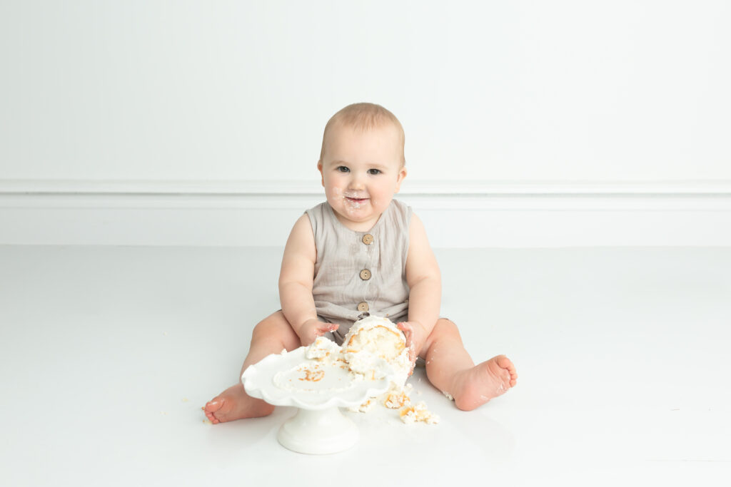 first birthday boy session with cake